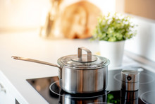 Stainless Steel Pot On Electric Stove With Kitchen Timer In Modern Kitchen. Cooking Utensils Concept