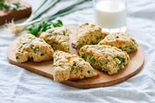 Savory Scones With Feta Mozzarella And Green Herbs On A Wooden Board.
