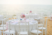 Wedding Table Setup At Beach Wedding Ceremony On The Beach With Sea And Sky