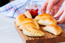 Homemade Potato Stuffed Empanadas With Ketchup On A Wooden Board. White Stone Background.