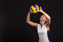 Girl Playing Volleyball On A D...