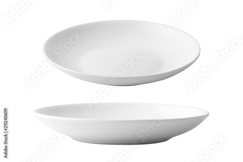 Photo White ceramic dish isolated on white background.