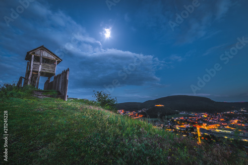 Spoed Foto op Canvas Grijze traf. View of Small City of Hainburg an der Donau as Seen from Braunsberg Hill with Oobservation Tower at Twilight