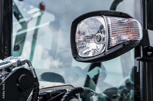 Obraz headlights and Parking lights of a truck, excavator, tractor or bulldozer or other construction equipment - fototapety do salonu