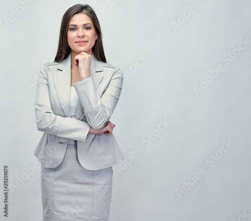 Smiling businesswoman in gray business suit. Wall mural
