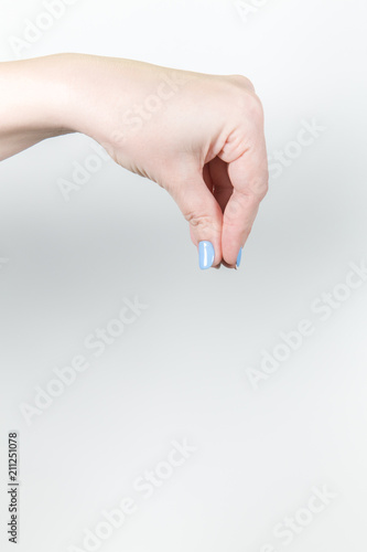 Vertical color photography of young female hand holding
