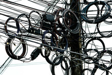 Tangled Electrical Wires On Urban Electric Pole. Disorganized And Messy To Organization Management Concept