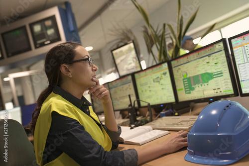 Fotografie, Obraz  Industrial technician working in monitoring control room