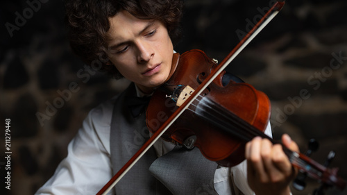 handsome guy with a violin Wallpaper Mural