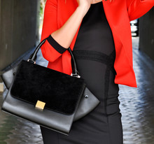 Sophisticated, Elegant Woman In Little Black Dress And  Red Blazer, Holding Leather-suede Black Handbag. Black And Red Combination For Every Occasion