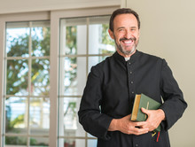 Christian Priest Man With A Happy Face Standing And Smiling With A Confident Smile Showing Teeth