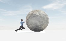 Man Pushing A Big Sphere To Th...