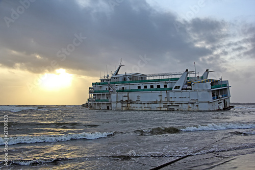Photo Marine vessel, to be used as offshore casino, run aground off Miramer coast in Goa, India, waiting to be salvaged
