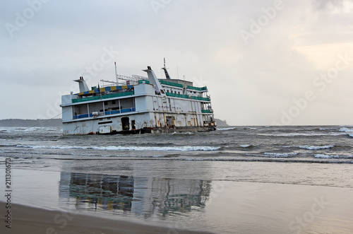Marine vessel, an offshore casino, that run aground near Miramer beach in Goa, India, waiting for rescue Canvas Print