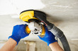 canvas print picture - concrete ceiling surface grinding by angle grinder machine