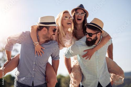 Papiers peints Kiev Cheerful young couples having fun on the beach