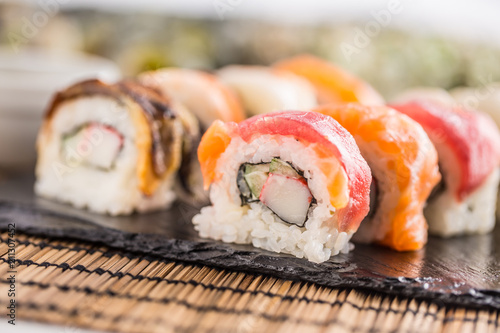 Staande foto Sushi bar Set of roll sushi gold california with chopsticks and soy sauce.