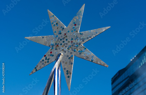 Fotografia  Decoration in the form of the star of Bethlehem  during the festive procession Alilo in Tbilisi