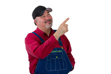 Smiling Worker In Dungarees Pointing Upwards