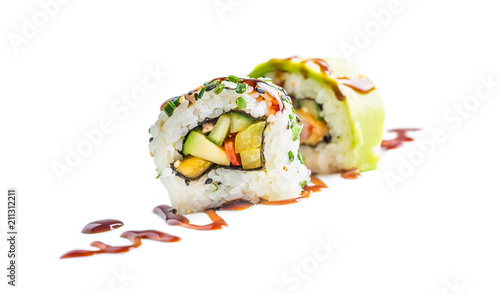 Sushi uramaki with soy sauce isolated on white background