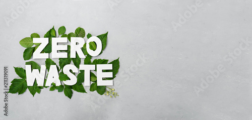 zero waste paper text witj green leaves on gray background Canvas Print