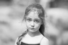 Portrait Of Little Girl In Summer In Park