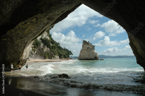 Cathedral Cove pictured from within the arch looking north along the sandy beach to the sea stack. Near Hahei, Coromandel, New Zealand.