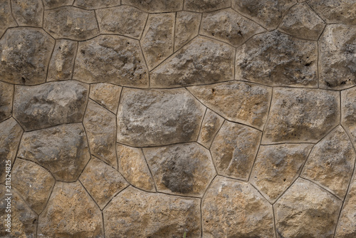 In de dag Stenen Old stone wall as texture or background. Old exterior wall with big rocks.