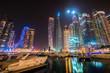 Dubai marina at night viewed from boat pier, UAE