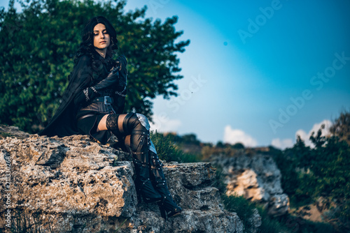 Fotografie, Obraz  Fantasy cosplay beautiful Witcher girl on cliff