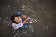 Asian Small Girl With Chalk