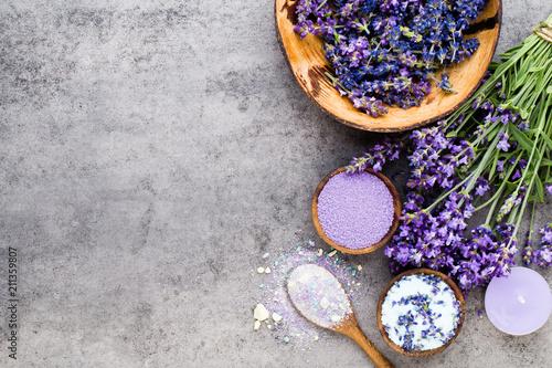 Fototapeta Essential lavender salt with flowers top view. obraz