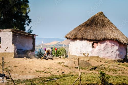 Woman cleaning the ground, Emahubhu, KwaZulu-Natal South Africa Wallpaper Mural