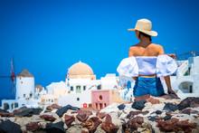 Female Tourist Exploring Oia V...