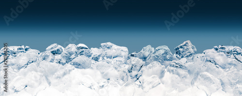 Fototapeta Pieces of crushed ice cubes on blue background. Clipping path included. obraz