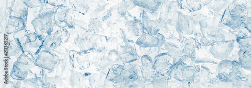 Ice cubes blue wide background.