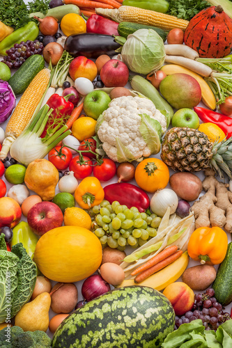 Fototapeta Vegetables And Fruits Large Fresh Overhead Mix Raw Food Vegetarian Arrangement Colorful Background In Studio