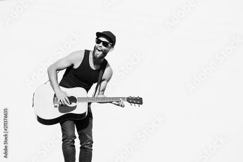 Fotografie, Obraz  Guitar player singing outside