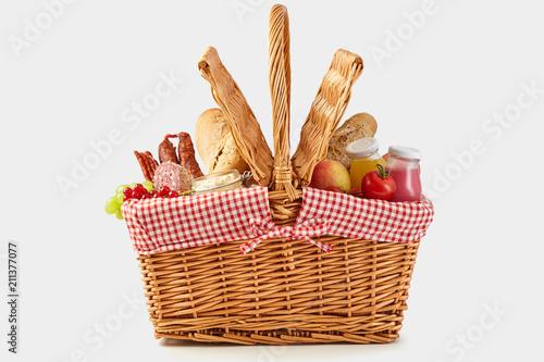 Obraz Delicious summer picnic food in a wicker hamper - fototapety do salonu