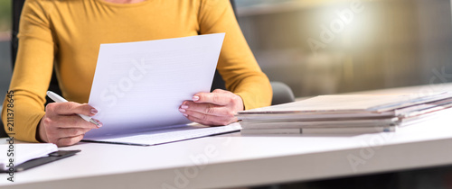 Businesswoman checking document - fototapety na wymiar