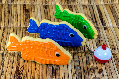 Fotografie, Obraz  fish cookies with red and white fishing bobber on bamboo mat
