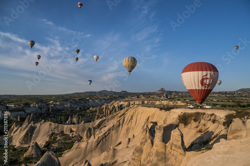 Poster Marron chocolat The great tourist attraction of Cappadocia - balloon flight. Cappadocia is known around the world as one of the best places to fly with hot air balloons.