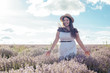 young pretty plus size female having fun in lavender field during sunset