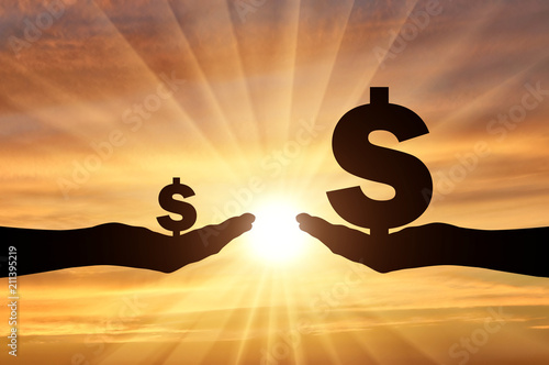Fototapeta Silhouette of two hands, in one hand a large symbol of Dollar. In the second hand is a small symbol of the dollar obraz