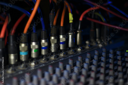 close up view of knobs and sliders of light and sound board console
