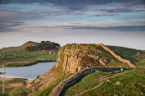 Poster Taupe Beautiful landscape image of Hadrian's Wall in Northumberland at sunset with fantastic late Spring light