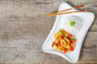 Fish in sweet and sour sauce. A dish of Chinese national cuisine. The view from the top. Copy-space.