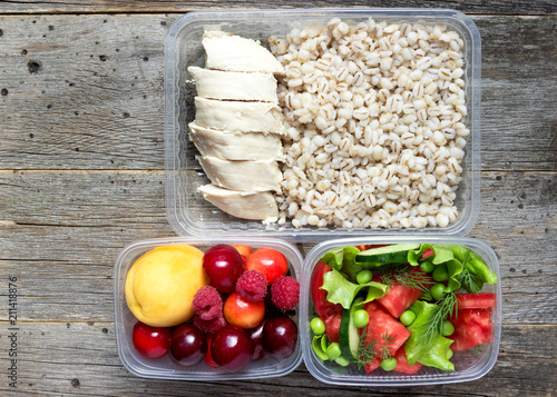 Poster Assortiment Healthy food, cooked in containers, pearl barley porridge with chicken breast, vegetables, fruits.
