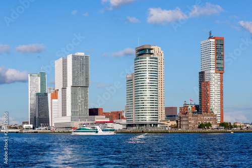 Staande foto Rotterdam Cityscape of Rotterdam with blue sky and clouds hanging over
