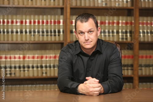 Photo Portrait of a professional man.  A  lawyer in law office.